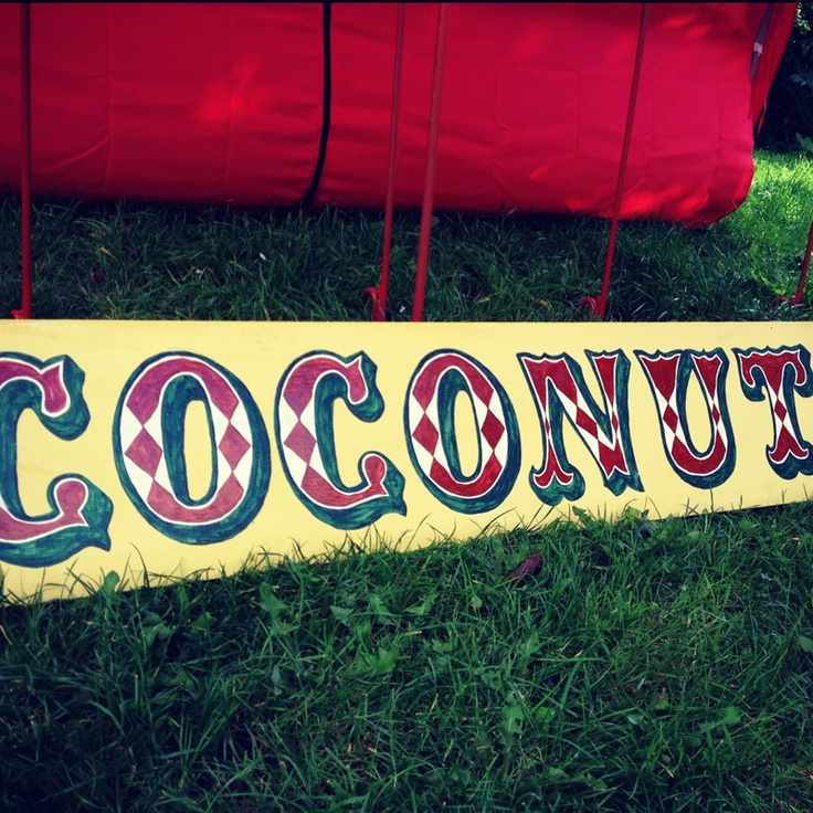 This coconut shy contains everything from the coconuts to the bucket of balls. 6 metal yellow and red striped rods are easily pushed into the ground. A surrounding red and white canopy with matching bunting and beautifully hand painted traditional signs. Hire all this for £70