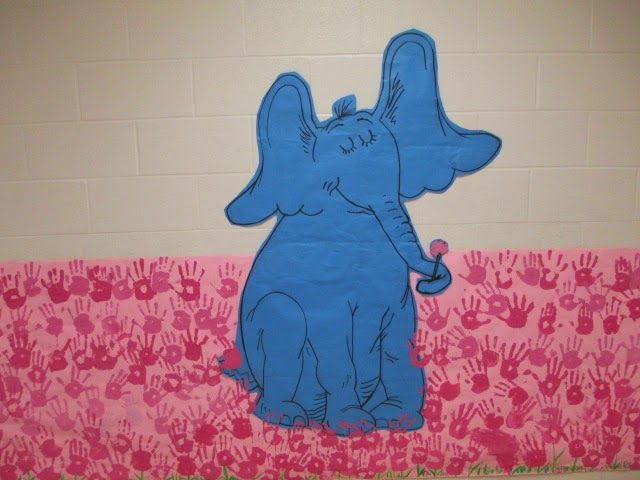 Horton found Whoville again in the clover field! A school mural using pink painted hands as clovers for our Dr. Seuss Read Across America Day. Music and Art's book was 'Horton Hears a Who'.