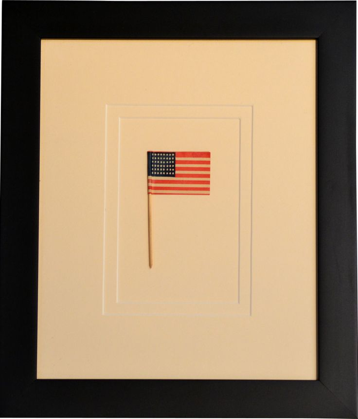 American Flags   a 48 star flag on a toothpick, framed archivally
