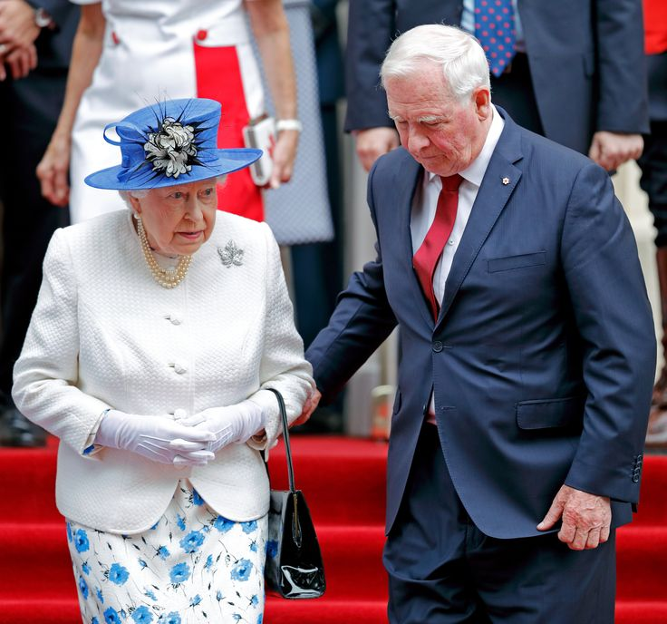 David Johnston, Governor General of Canada, holds Queen Elizabeth II's arm as she departs Canada House after attending a celebration to mark Canada's 150th anniversary of Confederation on July 19, 2017 in London, England.