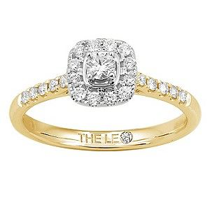 A stunning I-I1 colour and clarity round diamond in a cushion halo setting, on an 18ct gold ban, with diamond set shoulders, totalling 1/3ct. Handcrafted by diamond cutter Leo Schachter, the Leo Diamond is cut to reflect light like no other diamond. With its unique facet design, it is the first diamond to be independently measured for fire and brilliance.
