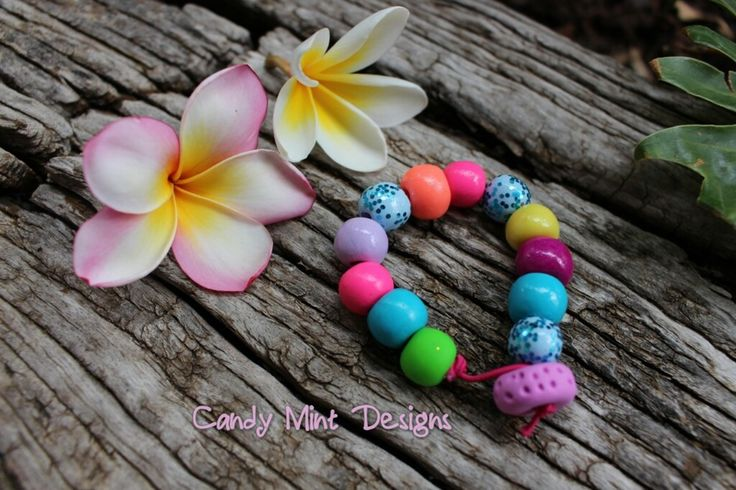 Gorgeous bracelet on coloured elastic with a flat bead to loop around. These are available in any colour scheme of your choice, on Hot Pink, Purple, White or Blue band. The beads can be hand stamped to match the kids necklaces.These bracelets are so cute, and can easily be made for adults too.