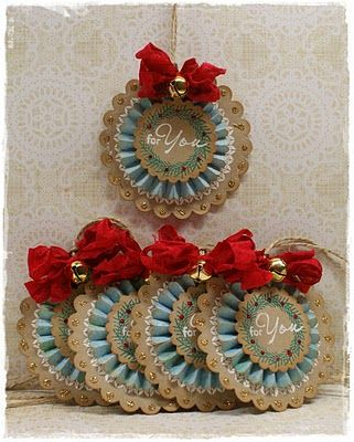 Christmas gift tags ... kraft & blue ... rosette and layers ... ribbon and bell ... would be beautiful keepsake to hang on a tree ...