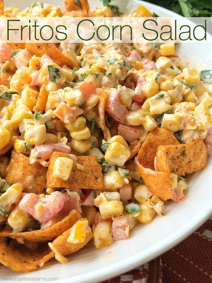 Fritos Corn Salad will be one salad that no one will forget! Loaded with corn, vegetables, a creamy spiced dressing, and then toss in an entire bag of Fritos Chili Cheese corn chips. Perfect salad for a BBQ, picnic, or a potluck. When I was little my family would have movie nights. My dad would …