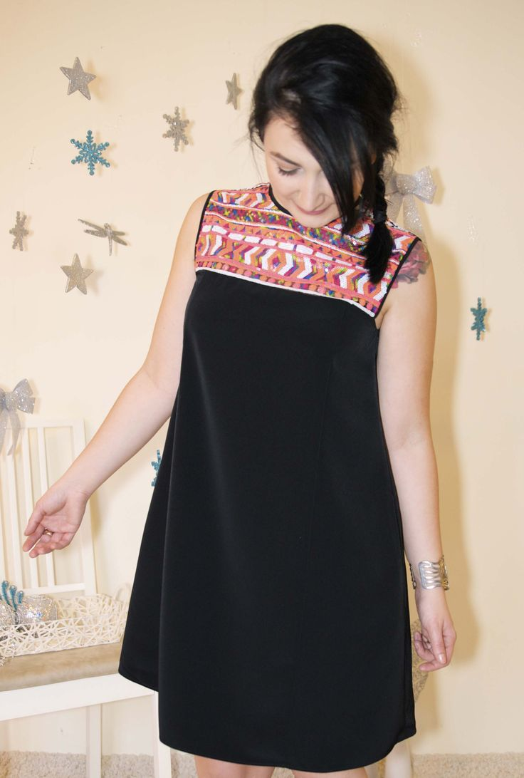 Flirty little black dress with coloured sequins embellishment.