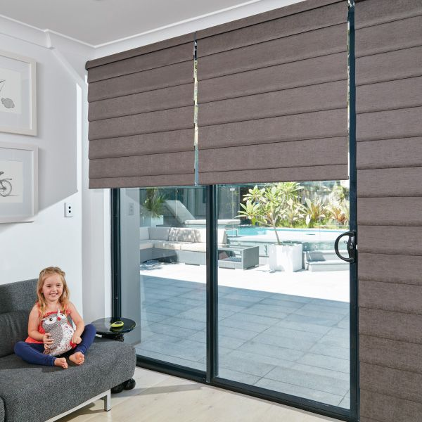 Luxaflex Modern Roman Shade Living Room Child Safe Blinds Solutions Roman Shades Living Room Modern Roman Shades Roman Blinds Living Room