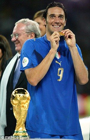 Luca Toni celebrates with his medal after Italy's World Cup win in Germany in 2006