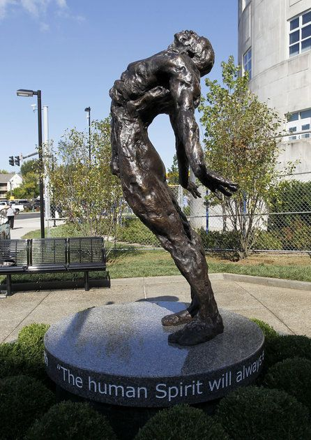 This is a sculpture at the University of Kentucky hospital. You can see around the circle the statue there is a quote. I wonder what this sculpture represents?