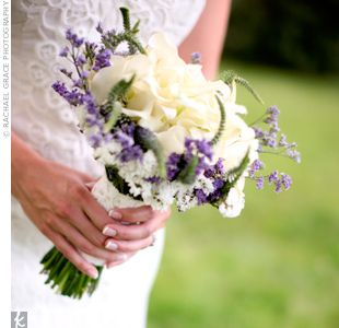 Hand-tied bouquet of white calla lilies collared with white and purple statice, caspia and Veronica.