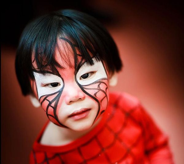 Spiderman makeup for Halloween. Got no time for a mask? Face paint your spidey mask on with just a red, white and black for the web design and whites of the eyes on the mask.