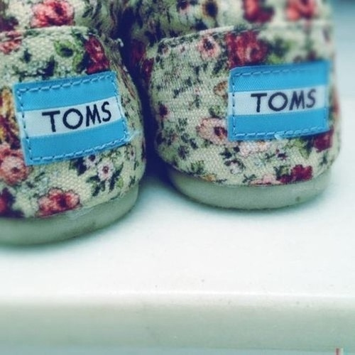 Floral toms, cute. I would buy these