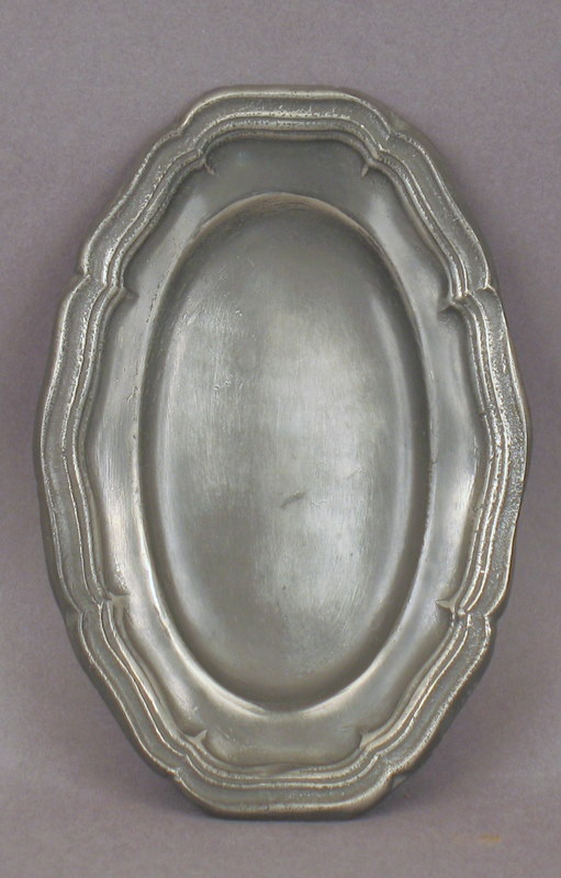 Pewter platter. I would enjoy owning this platter.