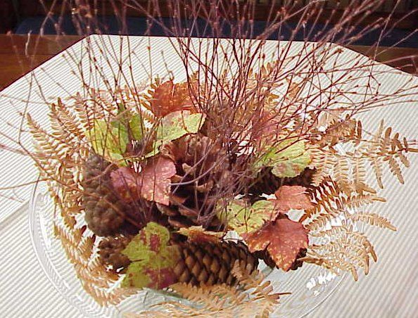 Pine cone and twigs centerpiece gather fall materials for