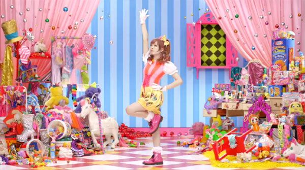 """The music video for """"PonPonPon"""" was shot by Jun Tajima. The theme of the music video is """"kawaii"""", which means cute in Japanese. The art director Masuda Sebastian, of fashion brand 6%DOKIDOKI, adopted the randomness of """"a room of a girl who isn't good at tidying up"""", adding """"a taste of the 60-70s"""".The fashion stylist for the video was Kumiko Iijima."""