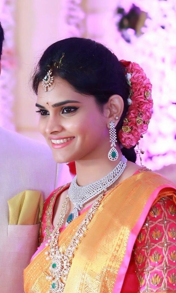 South Indian bride. Diamond Indian bridal jewelry. Jhumkis.Mustard yellow kanchipuram sari with contrast pink blouse.Braid with fresh jasmine flowers. Tamil bride. Telugu bride. Kannada bride. Hindu bride. Malayalee bride.Kerala bride.South Indian wedding