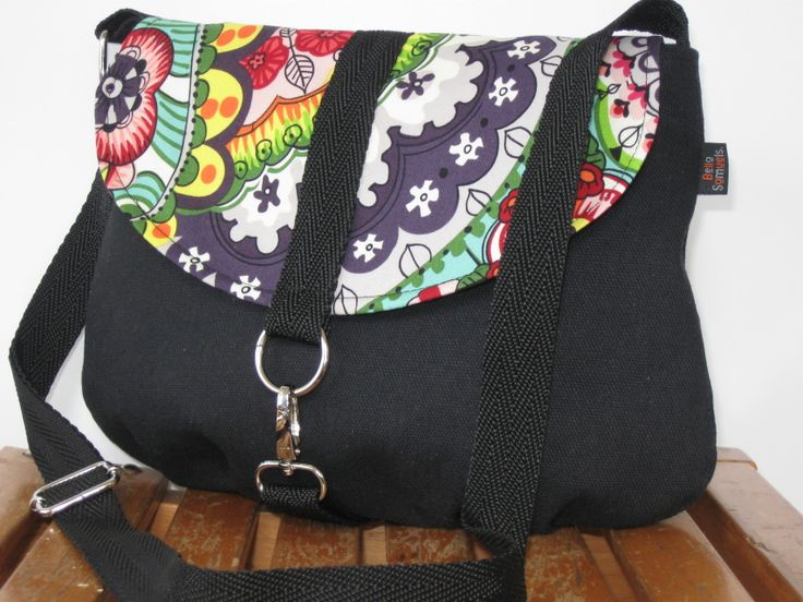 This is a super cute messenger style bag with the flap in a contrasting designer fabric by Alexander Henry Sloane. A smaller sized bag but still big enough to fit all your essentials.It can be worn as a shoulder bag or across the body if you need to be hands free. It features an adjustable strap, spring hook closure and inside pocket.