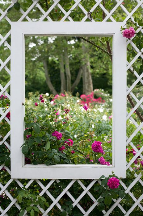 Frame a 'pretty as a picture' garden with a touch of garden whimsy by adding a fencing window. By   http://www.fenceinstallationguide.com/