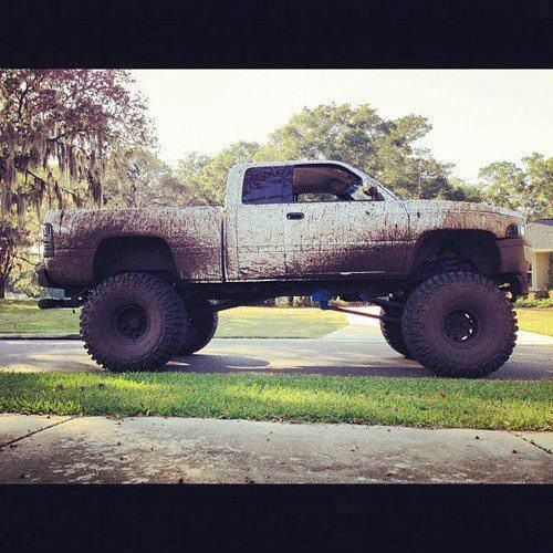 TRUCK YEAH! Muddy lifted white Dodge.