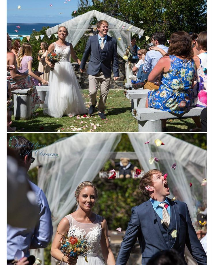 Sarah & Reece gobbling up the confetti petals at Dunes On Shelly Beach! Our dapper groom a tad hungry after hanging up front and centre! Pic Once Upon a Dream Photography