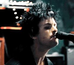I don't know if it's just me that noticed but in a lot of music videos and while preforming, for some reason Billie always has his lips all over the mic! XD He makes out with his mic and sings at the same time. Talent! Pure Talent!