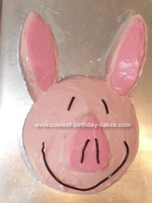Homemade Olivia the Pig Birthday Cake: I made a cake mix in two 8-in round pans.  I cut the ears and nose from one round cake.  Olivia's ears are uneven (which was easy to work with!) and she