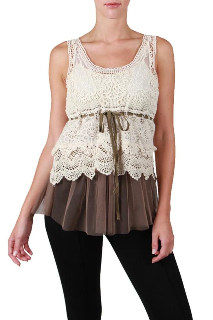 This little overlay top features beautiful cream colored crocheted lace on top of gathered taupe tulle with a taupe adjustable tie belt. This feminine top is perfect over a cream camisole. Wear it with a pair of heels to dress up your favorite jeans, but we also love it pair with a fitted maxi skirt and flats for an effortless look. It is available in 2 sizes (small/medium or medium/large).   Crochet Lace Top by Ryu:. Clothing - Tops - Sleeveless Colorado