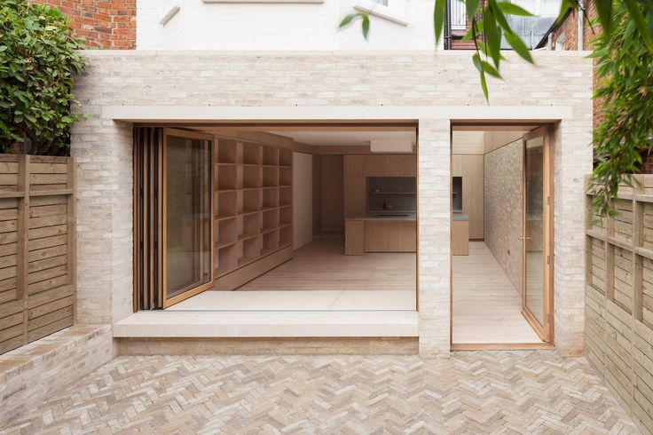 The London studio extended the rear of the early 20th-century mid-terrace house to increase the ground floor living space. The garden room comprises a kitchen, dining and playroom for the family's two young children.
