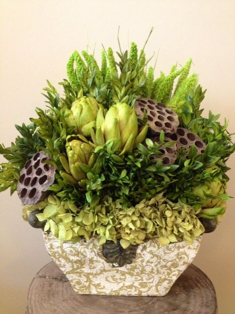 Custom Dried Floral Arrangement including: artichokes, pods, china millet, hydrangea and preserved boxwood.