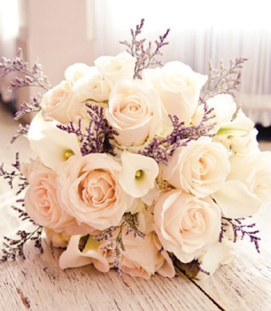Classic bridal bouquet, with roses and calla lilies.