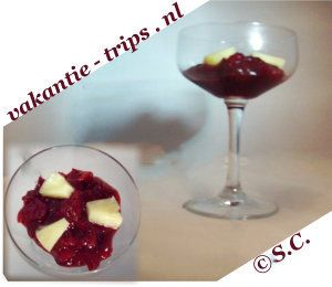Making a diner with cranberry and pineapple, served in a glass, seen from behind and from above