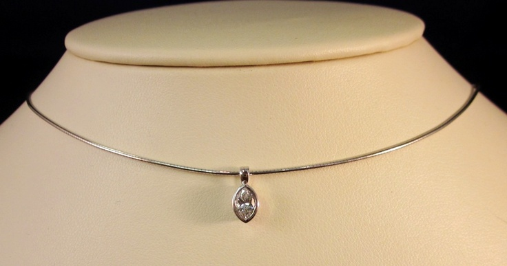 Marquis-cut diamond solitaire pendant, bezel-set in 14 karat white gold in a round white gold omega choker. In stock.
