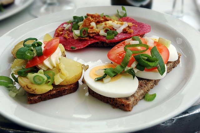 Smørrebrød is the traditional Danish open-faced sandwich. Usually it is made with dark rye bread, and topped with the most diverse variety of things: meats, fish, eggs, vegetables, you name it.