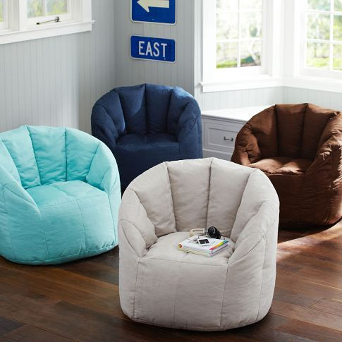 how bout 8 of these with a riser for 4 in the media room?  Cushy Club Chair | PBteen