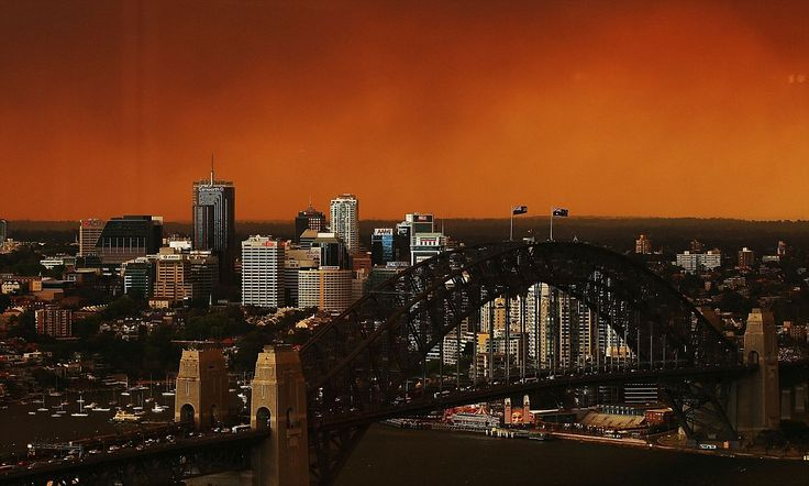 Sydney Harbour Bridge and North Sydney CBD shrouded in smoke haze as bushfires rage in the western Sydney suburbs of Springwood, Winmalee an...