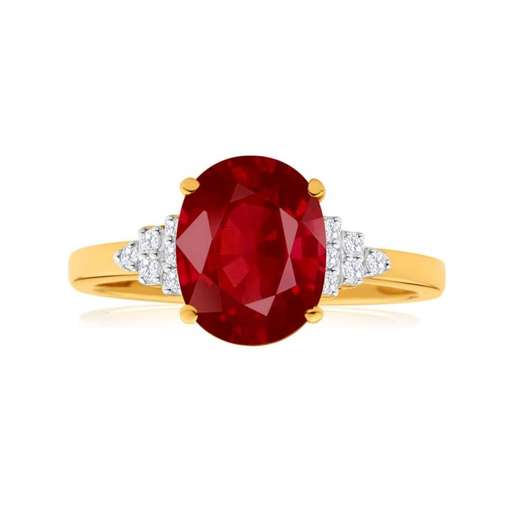Statement cocktail ring, perfect for that right hand finger! Natural Ruby ring with diamond side stones