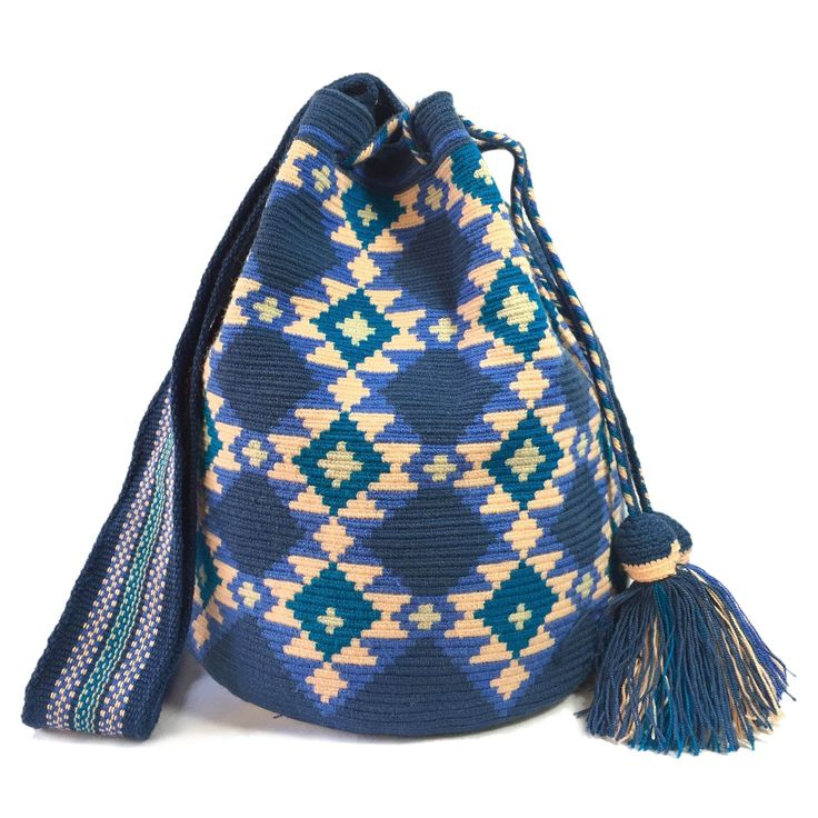 www.lombiaandco.com  The colors of this mochila Wayuu was inspired by the vivid colors that surround region of La Guajira. Sand, sea, desert, sun and a clear sky are constants in the landscape. Geometric figures are a signature ofthese mochila bags.