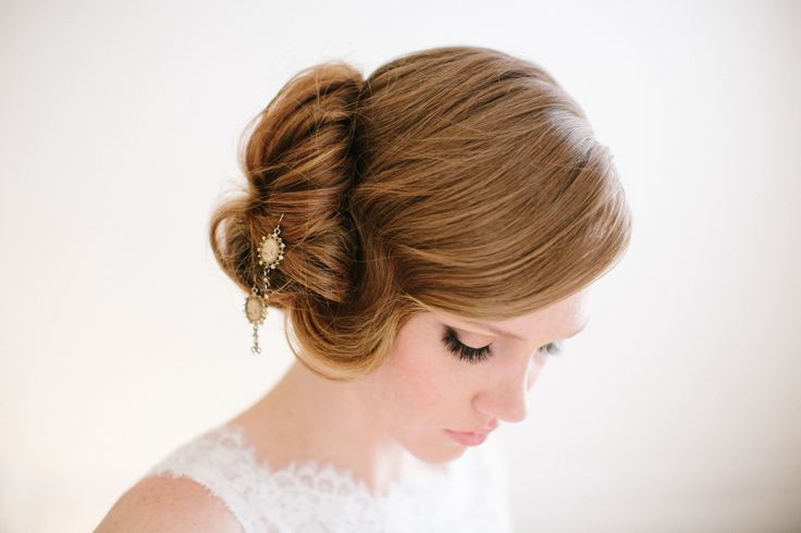 Something Old Something New.  Wear a set of heirloom earrings in your bridal hair style.  www.heatherchapmanhair.com