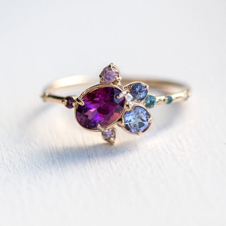 Wild Berry Jam Cluster Ring // Garnet, Tanzanite, Amethyst, Sapphire and London Blue Topaz in 14k Yellow Gold // Purple Asymmetrical Ring by MelanieCaseyJewelry on Etsy https://www.etsy.com/listing/506535059/wild-berry-jam-cluster-ring-garnet
