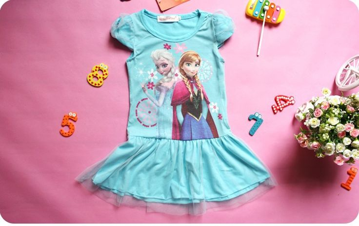 Blue cotton dress featuring Elsa & Anna print with tulle skirt and sleeves.