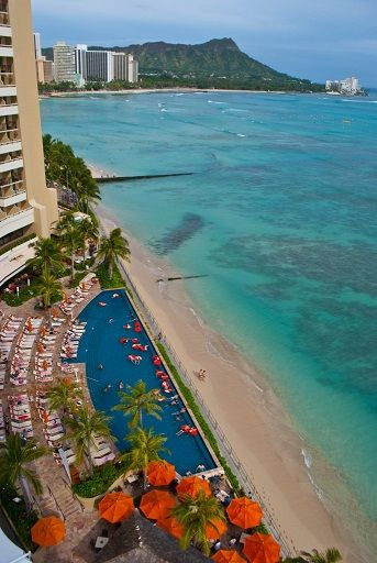 On the best stretch of white sand along Hawaii's most famous beach sits the towering Sheraton Waikiki.