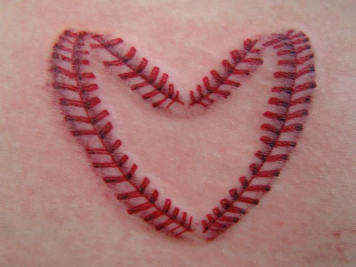 Jake Tattoo - Tulsa Tattoo Co realism heart baseball.. I THINK I JUST FOUND MY NEXT TATTOO