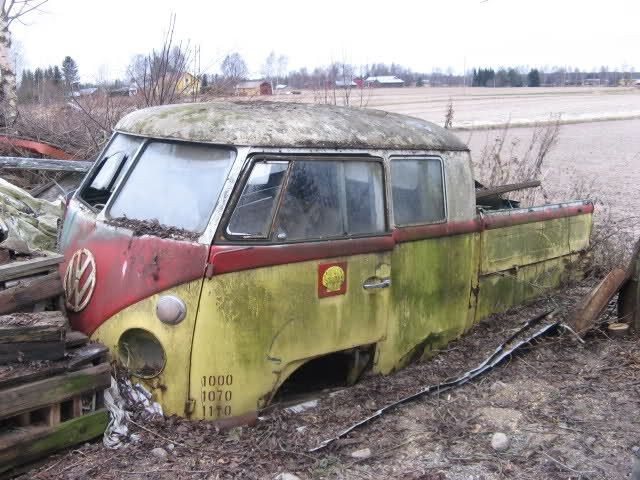 Double cab VW truck!  Still looks well worth digging out of the ground.  Interesting paint scheme too.