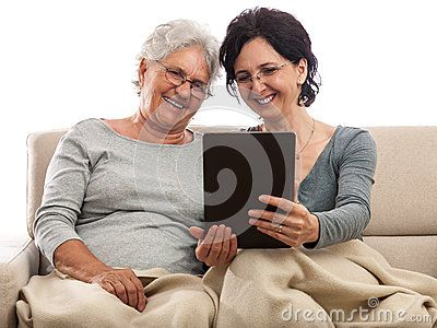 Happy people with big screen tablet. Adult women pointing at screen. Old women looking at photo. Isolated on white.