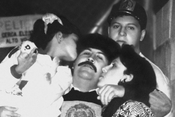 Pablo, kissed by daughter Manuela and wife Maria. Son Juan Pablo standing in the back.