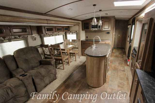 2016 New Kz SPREE 328IK Travel Trailer in Pennsylvania PA.Recreational Vehicle, rv, Inventory Reduction Sale! Was $47,641. Now Only $40,495! Don't Miss This Opportunity! Relax in style! The 2016 Spree 328IK travel trailer by KZ offers a balanced mix of comfort and function in a very luxurious travel trailer. The 328IK has a UVW of 8,390 lbs, 3 slides and sleeps up to 4, and has an outside kitchen! Inside this beautiful trailer there is a ducted 15,000 BTU A/C, ducted heat, an island kitchen…