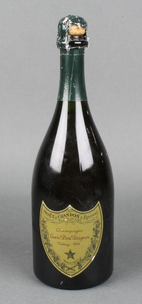 Lot 192, A bottle of 1964 Moet & Chandon Dom Perignon champagne (slight damage to green paper wrapper), sold for £120
