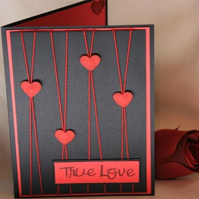 handmade Valentines Day Card ... black card .. red mat, punched hearts, string and sentiment block .. luv how the string lines are integral part of the design ...