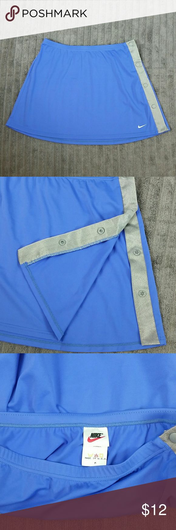 "Nike Cover-up Mini Skirt w/Side Snaps Blue & Gray Pretty Skirt.  Blue with gray stripe on side.  4 plastic snaps that work well.  79% Nylon  21% Lycra Spandex   Measurements  (laying flat):  Length 14"",   Waist Across 13.5""  Color:  Blue & Gray Nike Skirts Mini"