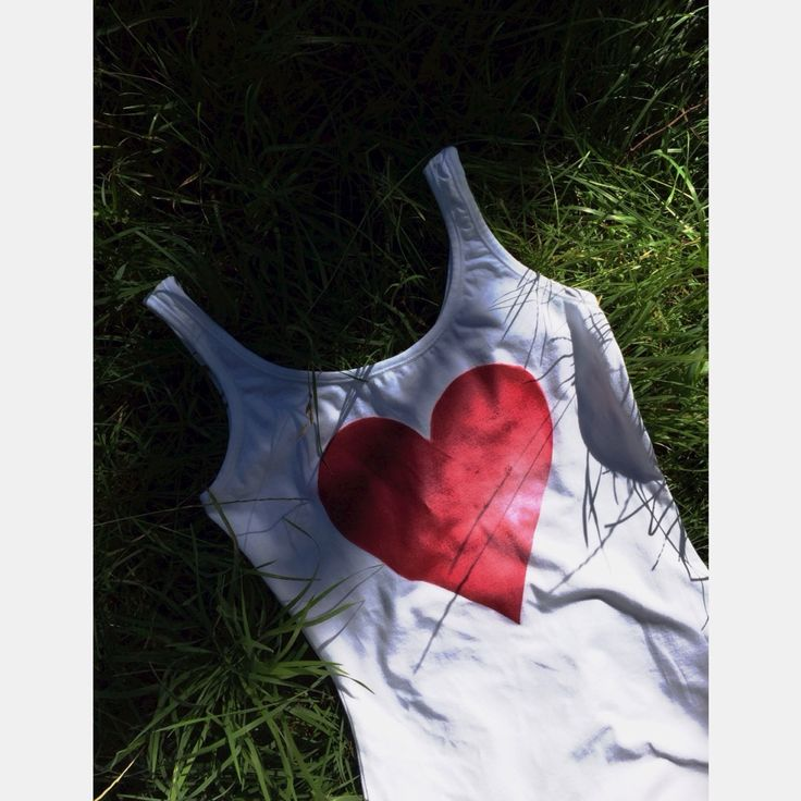 limited edition ➕one 'simply red' singlet designed + individually hand-painted  by Claire Webber, Hobart, Tasmanis. Also available in a white s/s tee in sizes 10-16. Eco friendly water based fabric paints enquiries webberclaire1@gmail.com