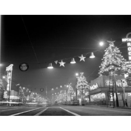 USA California Los Angeles Hollywood Hollywood Boulevard at night looking East showing Christmas lights Canvas Art - (18 x 24)